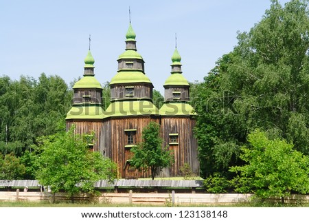 Pirogovo, Kiev, Ukraine - Antique traditional wooden church - stock photo