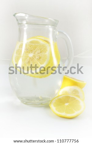 pitcher of water and  lemon