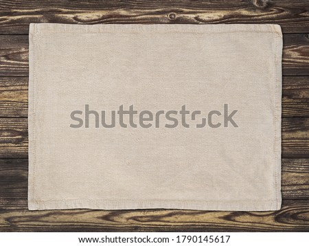 Placemat placed on a brown table Stock photo ©
