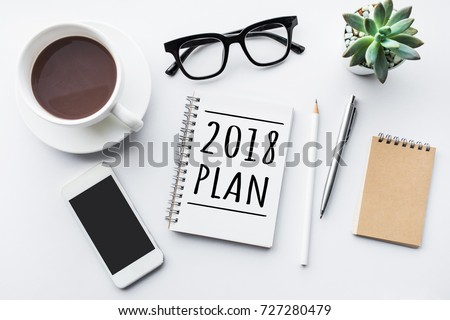 2018 plan text on notepad with office accessories.Business motivation,inspiration concepts #727280479
