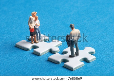 2 plastic figures standing on 2 puzzleparts