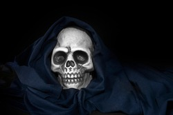 plastic human skull on  black background