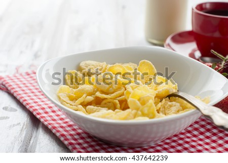 plate of cereal, strawberries, a bottle of milk and a cup of coffee - a healthy breakfast. The concept of proper nutrition #437642239
