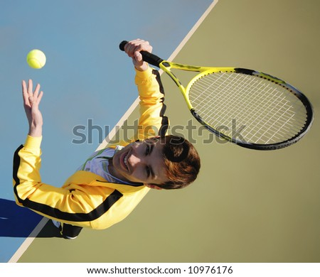 player in tennis on court in  bright sunny day