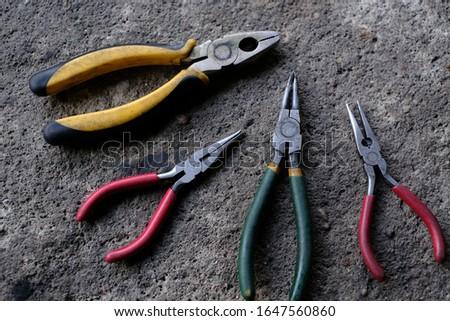 Pliers, tools, tools, tools, arranged lined