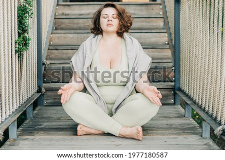 Plus size woman doing yoga and meditation. ストックフォト ©
