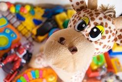 plush giraffe and various plastic toys