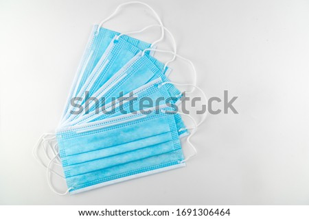 3 ply surgical face mask isolated on white background.