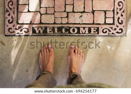 point of view of bare feet at...