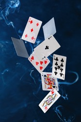 poker cards and chips fly in the air