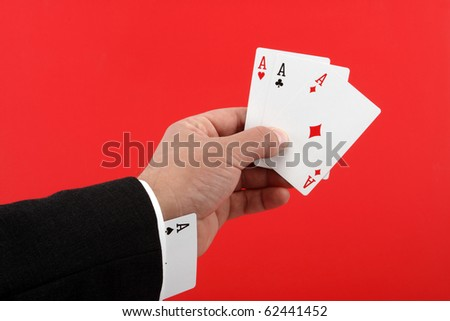 poker player cheating with four aces over red