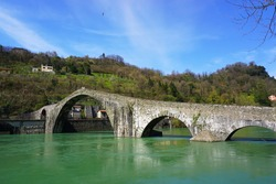 Ponte della Maddalena, a pedestrian stone bridge across Serchio river, is dating from 1100 AD and was used by pilgrims in the Middle Ages