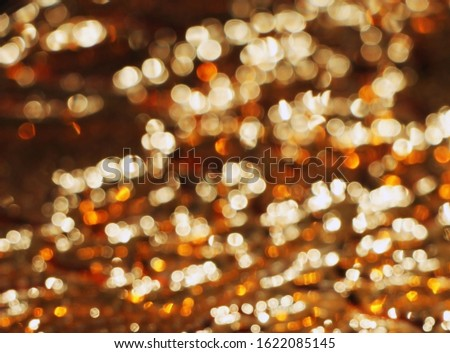 Poor eyesight. Defocusing. Color bokeh. Brown and gold background. Blurry texture. Design.