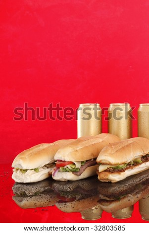 3 popular sandwiches and golden cold cans - Chicken Caesar, Deli giant and Philly
