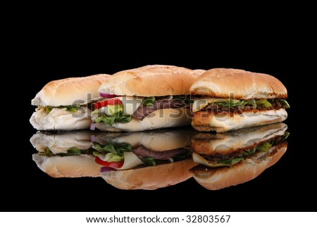 3 popular sandwiches - Chicken Caesar, Deli giant and Philly on black