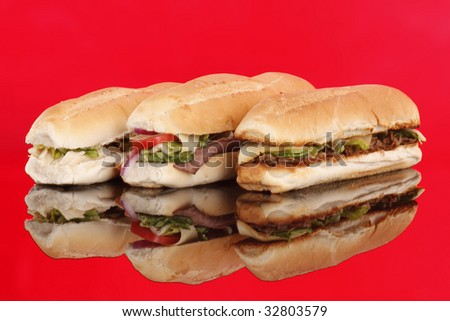 3 popular sandwiches - Chicken Caesar, Deli giant and Philly on red