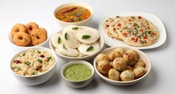 Popular South indian breakfast Uttapam, Idli/idly, Wada/vada, sambar, appam, upma served with chutneys, selective focus