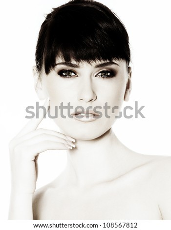 portrait of a beautiful brunette girl with healthy beautiful hair and  glossy face, natural make-up, photographed in the studio against a plain white background