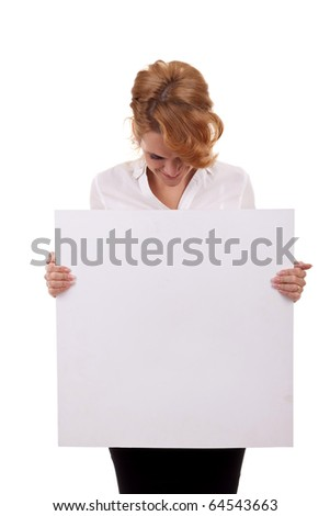 Portrait of a beautiful business woman holding a blank billboard, looking out from behind it. beautiful woman and blank sign