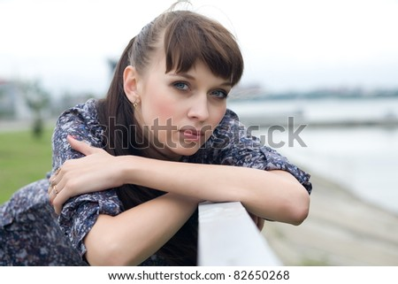 Portrait of a beautiful girl with dark hair