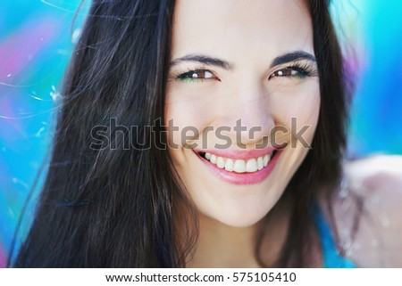 Stock Photo  portrait of a brunette girl on a colored background