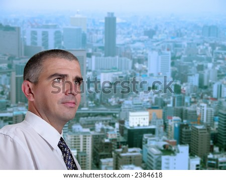 Portrait of a business manager in his office near the window in a metropolis.