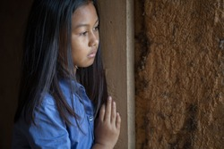 Portrait of a poor little thailand girl lost in deep thoughts, poverty, Poor children