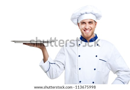 Portrait of a professional chef holding an empty dish. Isolated on white