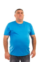 Portrait of a serious  man in t-shirt isolated on white background
