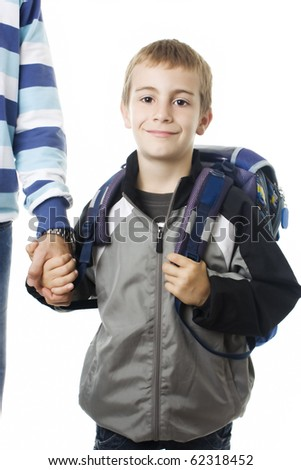 Portrait of an adorable young boy going to school with his father against white background