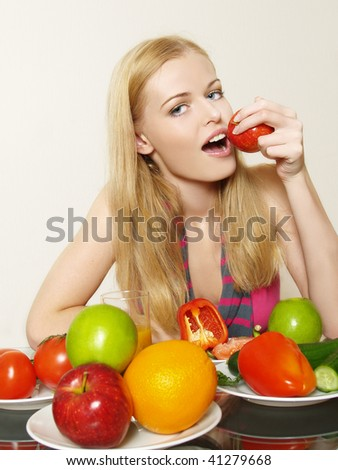 Portrait of beautiful girl with vegetable and fruit - stock photo