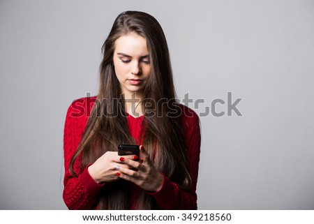 Portrait of beautiful young woman holding mobile phone #349218560