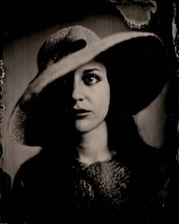 Portrait of girl with hat.Wet plate 8x10 inch. Real wet plate collodion photography with silver bath, shooted with a 150 years old brass lens.Tintype. Large format.