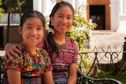 Portrait of happy indigenous girls smiling, looking at camera.