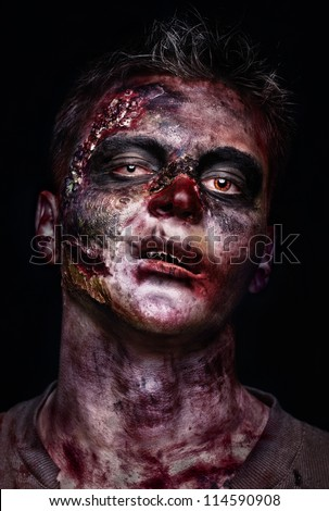 portrait of scary bad zombie at night - stock photo