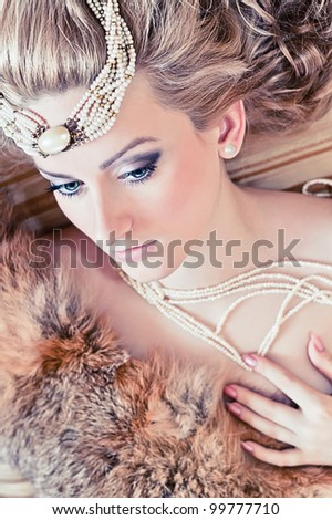 Portrait of the attractive blond woman with fur