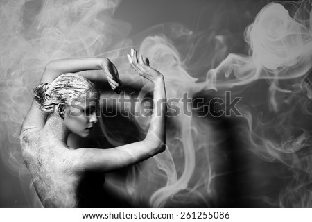 Portrait of the beautiful naked woman. Abstract smoke. Black and white photography. Body care. Spa. Mask of clay