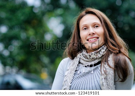 portrait of the young woman against the nature, smiles