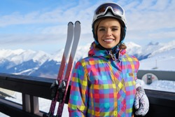 Portrait of woman in ski outfit. Portrait of cheerful blond woman at ski resort