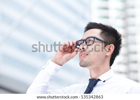 Portrait of young business man of Asian