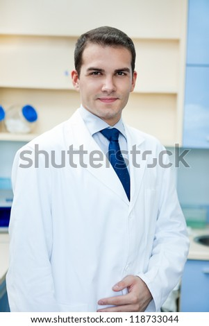 portrait of young handsome success doctor