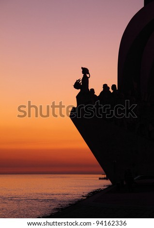 """Portugal Lisbon Belem District """"Monument to the Portuguese voyages of Discovery"""" """"Padrao dos Descobrimentos&quot ; in silhouette at Dusk over the River Tagus River - stock photo"""