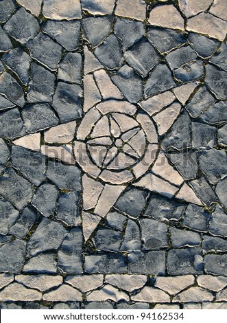 "Portugal Lisbon Belem District typical Portuguese mosaic ""calcada"" paving stones depicting a star"
