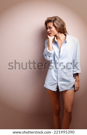positive young woman in big man shirt