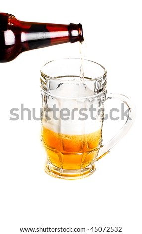Pouring beer into mug over white background