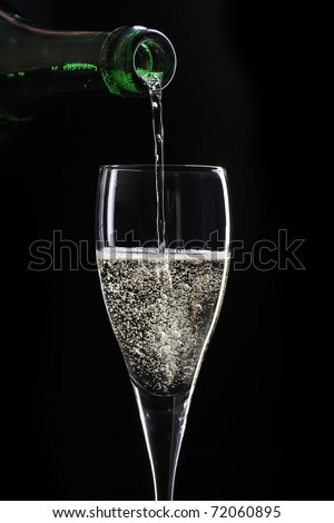 pouring champagne on black background