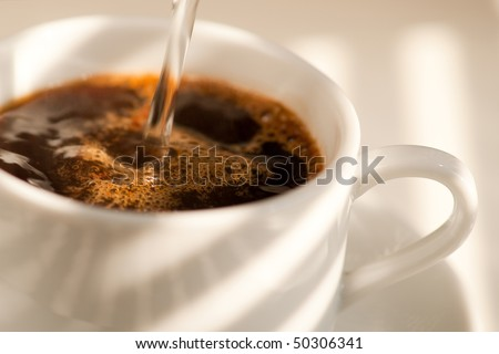 Pouring Coffee into a cup