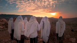prayer With  Talit and tefillin in sunset