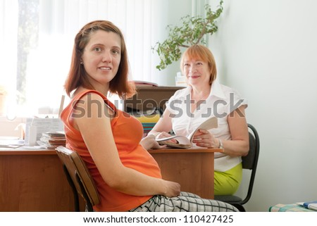 pregnant woman during medical examination  in clinic - stock photo