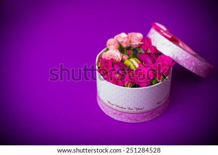 present box with flowers and macaroons violet background for valentines mother day easter with love